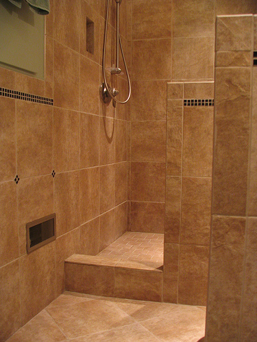 Custom Travertine Shower Designs With Glass Tile Accents