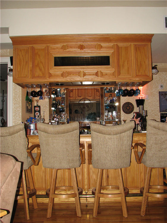 A Custom Natural Red Oak Bar With Complimenting Rear Wet Serving Area