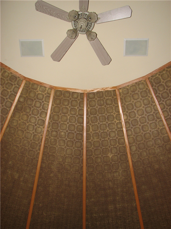 A Custom Faux Tin Ceiling's Multiple Faces Separated By Wooden Dividers