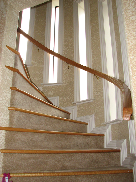A True Half Round Stair Well With Curved Window Sills and Oak Stair Nosing and Rail