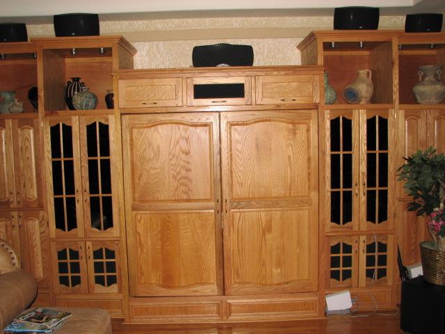 A Custom Natural Red Oak Entertainment Center Housing a Big Screen TV