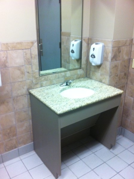 Roll under vanity with lift out panel for protection from pipes