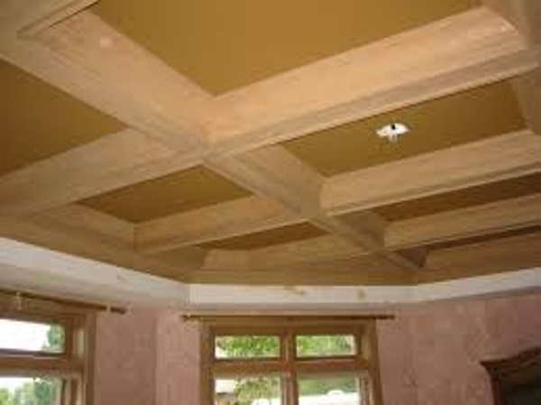 Contrasting beams and drywall ceiling