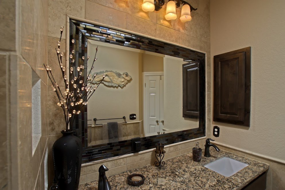 Glass tiles used to frame a beveled mirror