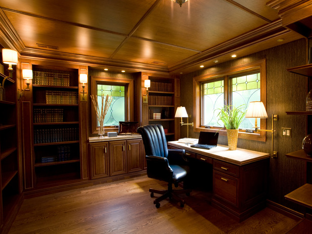 A home office with a warm wooden ceiling